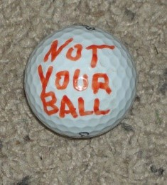 funny golf ball marking